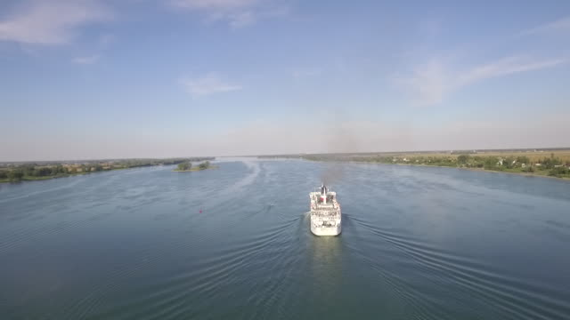 aerial view of ship on river - transportation stock videos & royalty-free footage