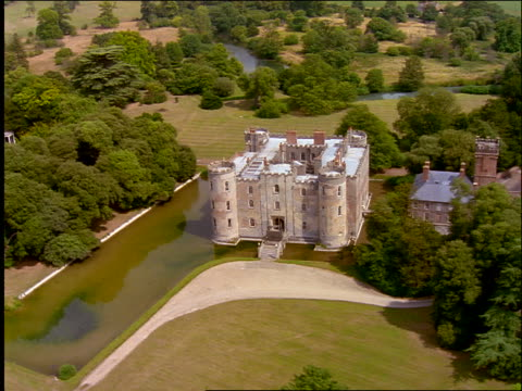 aerial of shirburn castle with moat in english countryside / oxfordshire - moat stock videos and b-roll footage