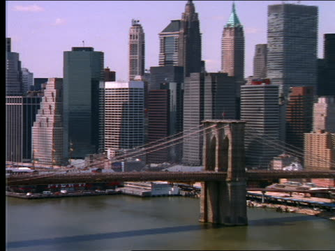 aer of south st seaport, brooklyn bridge, manhattan bridge - world trade center manhattan video stock e b–roll
