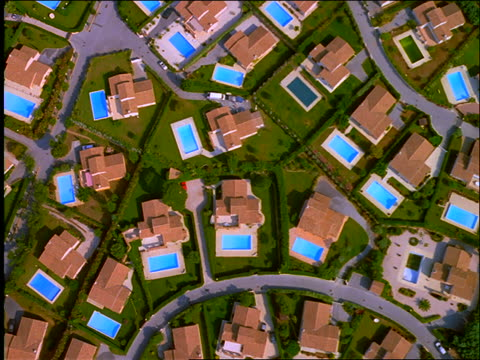 AERIAL of suburban houses with swimming pools / Beauvallon, Provence, France
