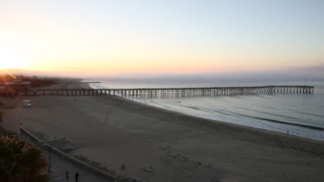 tl of sunrise over beach and pier, overhead view - ventura stock videos and b-roll footage