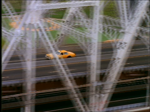 AERIAL of taxi crossing 59th Street Bridge / skyline in background