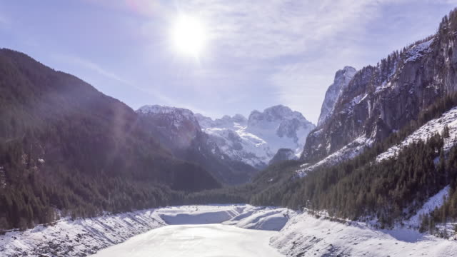 tl of the dachstein mountains at gosausee in winter - dachstein mountains stock videos and b-roll footage