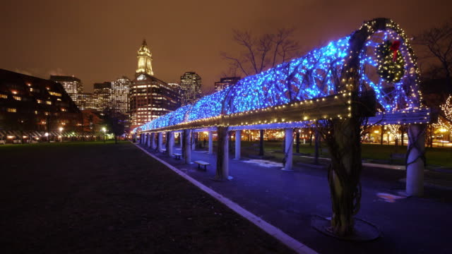 w/s of the illuminated trellis with christmas light decoration in the columbus park in boston, ma. - custom house tower stock videos & royalty-free footage