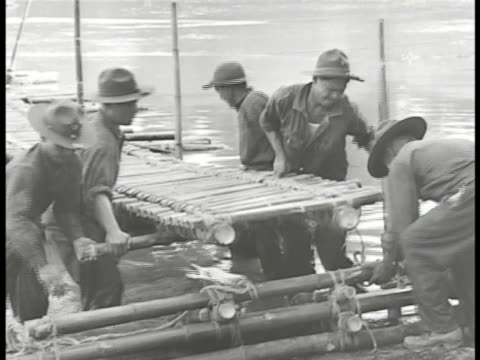 commonwealth of the philippines defense filipino soldiers training putting together natural bamboo pontoon bridge soldier using survey equipment on... - pontoon bridge stock videos and b-roll footage