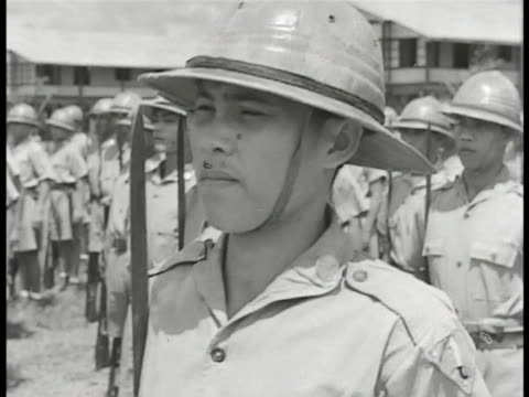 vídeos de stock, filmes e b-roll de commonwealth of the philippines defense first infantry division philippines army officer giving orders soldiers standing in formation at attention... - filipino