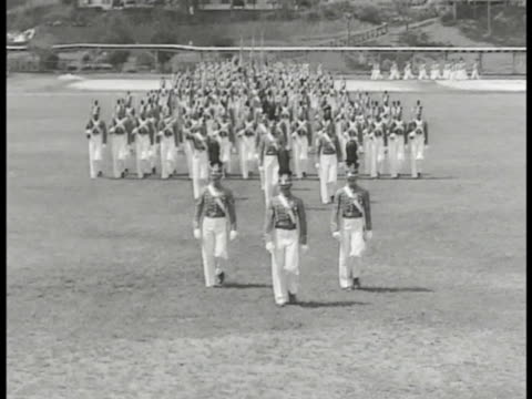 stockvideo's en b-roll-footage met commonwealth of the philippines defense ha ws philippine military academy cadets in uniform marching in parade formation on open field ms cadets... - filipijnse etniciteit