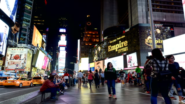 time lapse of tourist in times square, nyc - advertisement stock videos & royalty-free footage