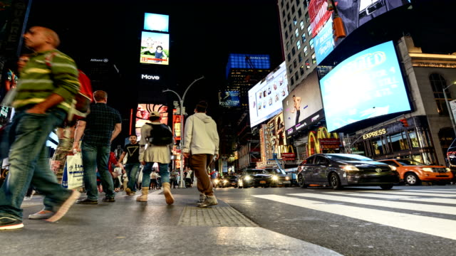 time lapse of tourist in times square, nyc - digital signage stock videos and b-roll footage