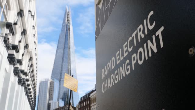 of traffic and electric car charging points across london as britain plans to ban petrol and diesel vehicle sales from 2030 as part of a 10-point... - fuel and power generation stock videos & royalty-free footage