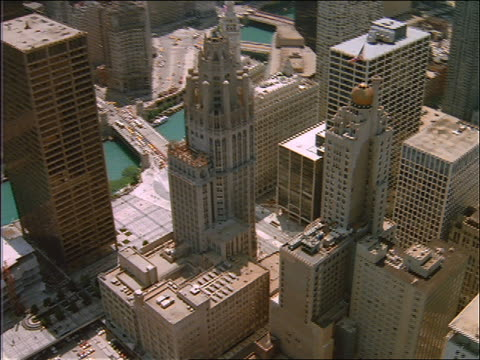 aerial of tribune tower + other bldgs on chicago river - tribune tower stock-videos und b-roll-filmmaterial