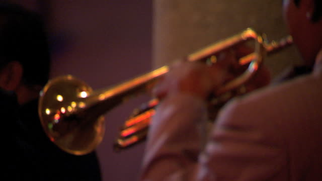 back of trumpet being played by unidentifiable male band live music jazz brass instrument street performer - brass instrument stock videos & royalty-free footage