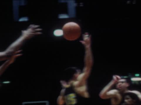 of ucla bruins basketball center lew alcindor, aka kareem abdul-jabbar playing in game against the university of washington huskies. abdul-jabbar... - university of washington stock videos & royalty-free footage