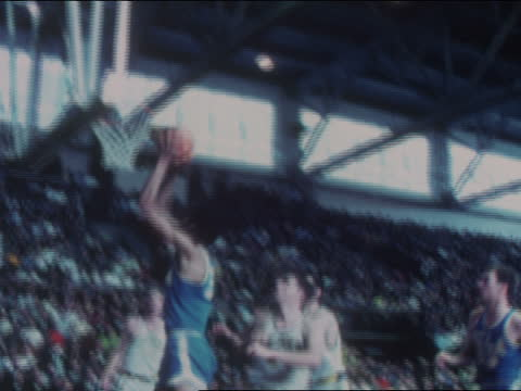 of ucla bruins basketball center lew alcindor, aka kareem abdul-jabbar scoring around the post, taking a pass from guard kenny heitz and scoring,... - westwood neighborhood los angeles stock videos & royalty-free footage