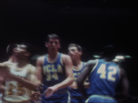 of ucla bruins basketball point guard lucius allen making shots at basket during game against usc trojans; vo of teammates lew alcindor aka kareem... - westwood neighborhood los angeles stock videos & royalty-free footage