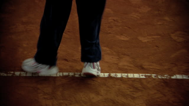 of unidentifiable young girl w/ tennis racket on indoor tennis court stepping side to side, ready for opponent serve. - tennis racket stock videos & royalty-free footage