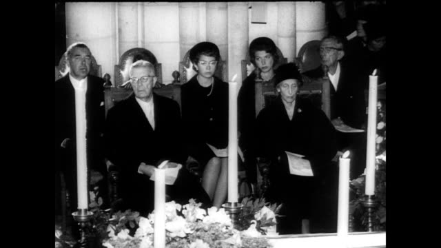 / ext of uppsala cathedral / cu hammarskjold's coffin / various dignitaries and attendees milling about the inside of the cathedral / coffin laid on... - uppsala stock videos and b-roll footage