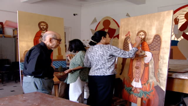 of women painting icons in a workshop, including one of john the baptist. he is often painted with wings in orthodox icons to symbolize his status as... - baptist stock videos & royalty-free footage
