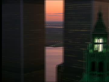 stockvideo's en b-roll-footage met aerial of woolworth bldg + world trade center / twilight - world trade center manhattan