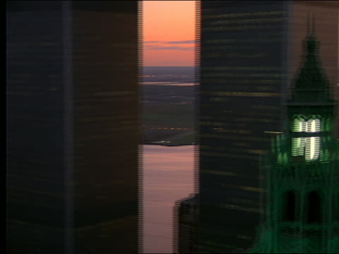 vídeos de stock e filmes b-roll de aerial of woolworth bldg + world trade center / twilight - world trade center manhattan