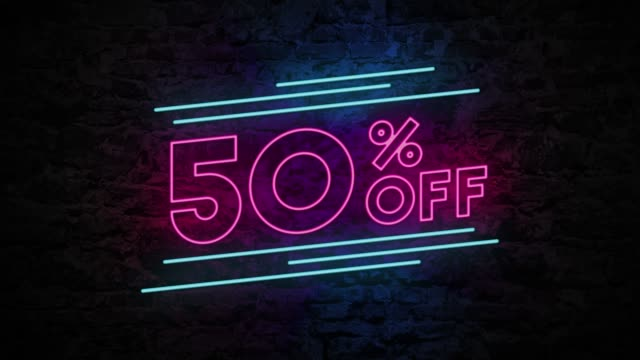 50% off neon sign on brick background 4k animation - saldi video stock e b–roll