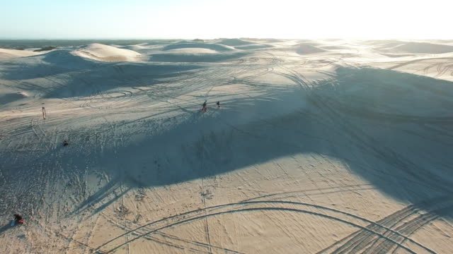 off on an epic sand boarding adventure - namibian desert stock videos and b-roll footage
