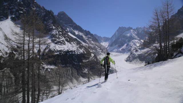 ws off piste skier trekking through fresh snow slope/french alps - skijacke stock-videos und b-roll-filmmaterial