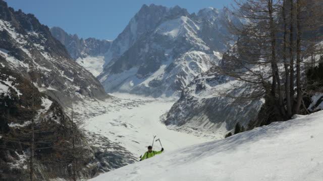ls off piste skier trekking through fresh snow slope/french alps - skijacke stock-videos und b-roll-filmmaterial