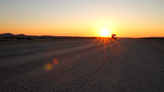 off road car in namibia at sunset - off road car stock videos and b-roll footage