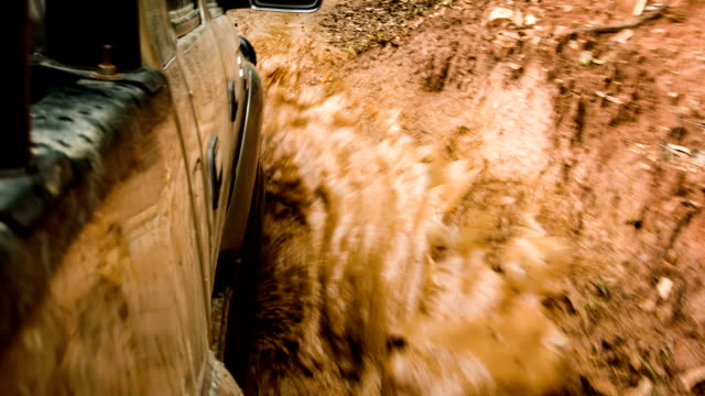 off road car with muddy road. - off road car stock videos and b-roll footage