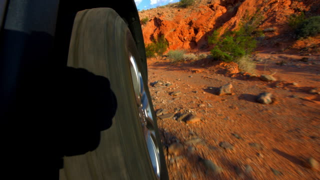 off road desert driving in suv low angle view in early morning hour - off road car stock videos and b-roll footage