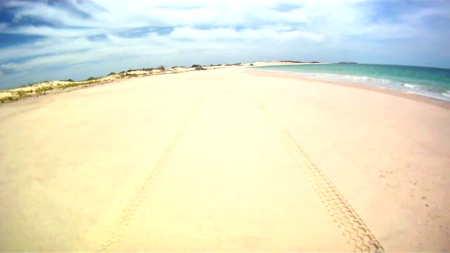 hd time lapse: off road driving on the beach - vignette stock videos & royalty-free footage