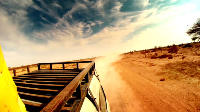Off road in desert in Africa. Roof rack close-up.
