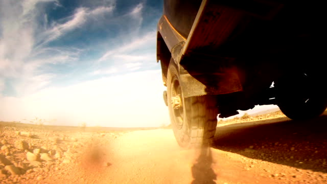 off road in desert in africa. tread on the tire close-up. - dirt track stock videos & royalty-free footage
