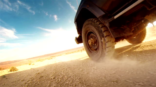 stockvideo's en b-roll-footage met off road in desert in africa. tread on the tire close-up. - sports utility vehicle