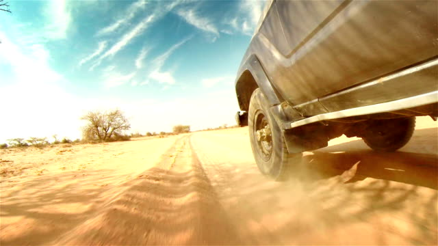 off road in desert in africa. tread on the tire close-up. - off road car stock videos and b-roll footage