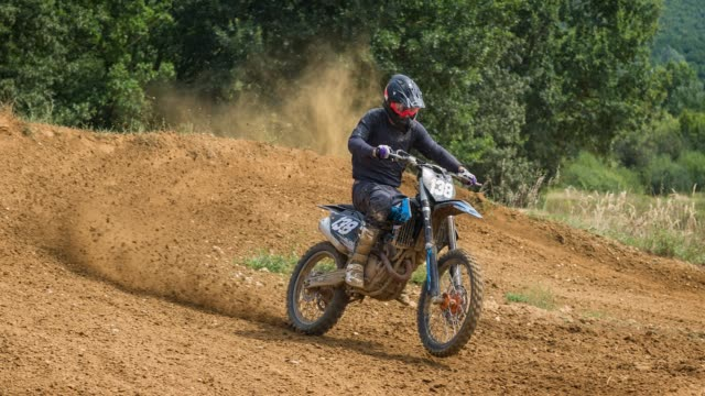 off road motorcycle racing, riding motocross bike on dirt track - off road racing stock videos & royalty-free footage