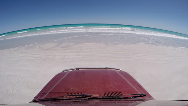 off road vehicle parked on cable beach looking at the indian ocean seen from vehicles perspective, broome, australia - natural parkland stock videos & royalty-free footage