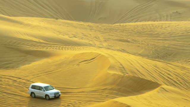 off road vehicles desert safari drives sand dunes - aufprall stock-videos und b-roll-filmmaterial
