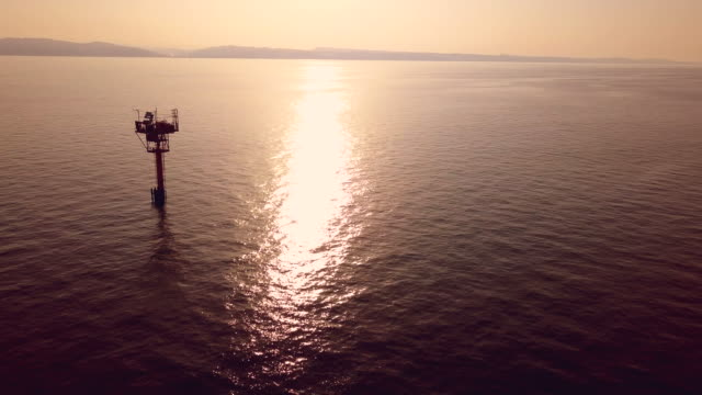 off shore natural gas station in italian mediterranean sea - galleggiare sull'acqua video stock e b–roll