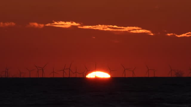 off shore wind farm at sunset - power supply stock videos & royalty-free footage
