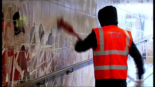 Offenders help clean Westminster in preparation for royal wedding Hyde Park Station INT Various of offender wearing 'Community Payback'...