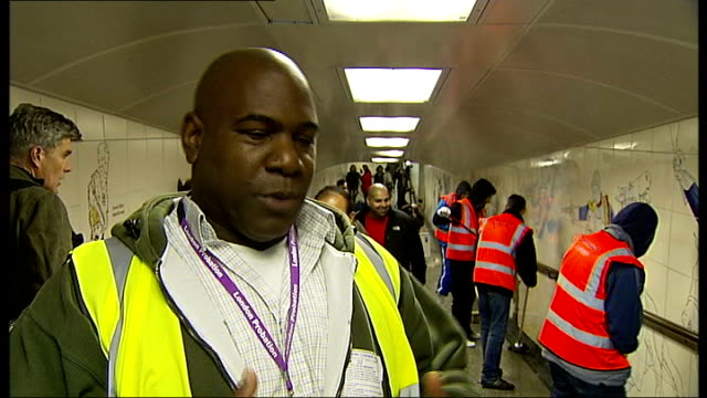 offenders help clean westminster in preparation for royal wedding england london int various of offenders wearing 'community payback' fluorescent... - man and machine stock videos & royalty-free footage
