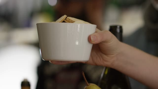 offering a cracker and accepting in a white bowl during a party - cracker stock videos and b-roll footage