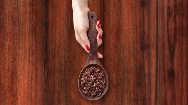 offering boiled black rice - sfondo marrone video stock e b–roll