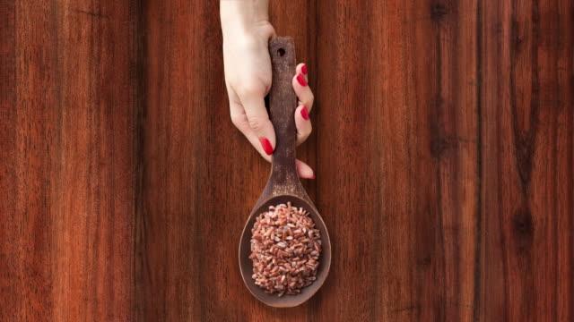 offering boiled red rice - sfondo marrone video stock e b–roll
