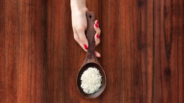 offering boiled white rice - sfondo marrone video stock e b–roll