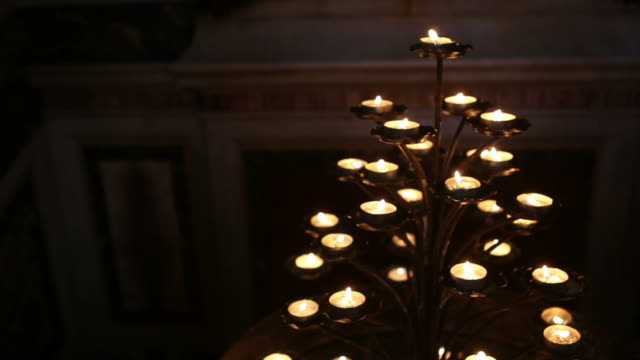 Offering Candles inside a church in Rome