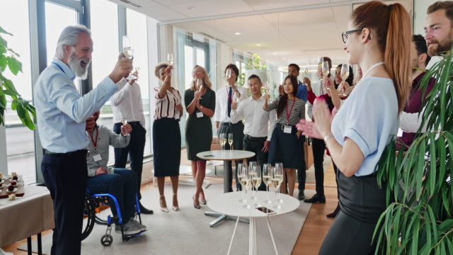 ceo offering celebratory toast at new business launch party - launch event stock videos & royalty-free footage