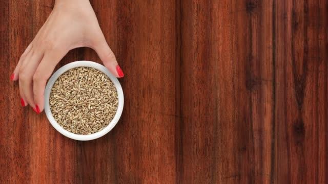 offering fennel seeds - sfondo marrone video stock e b–roll